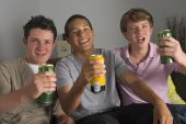 stock photo of underage  - Teenage Boys Drinking Beer - JPG