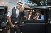 stock photo of shotgun  - Handsome 1920 era gangsters with pretty woman
