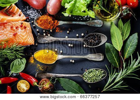 Delicious  portion of fresh salmon fillet  with aromatic herbs, spices and vegetables - healthy food poster