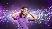 image of glow  - Pretty young woman with headphones listening to music - JPG