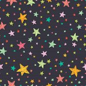 foto of cosmic  - Seamless pattern with night sky and colorful hand drawn doodle stars - JPG