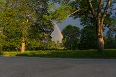 foto of end rainbow  - The end of the rainbow lands between the trees - JPG