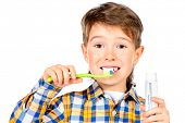 picture of tooth gap  - Little funny boy smiling and brushing his teeth - JPG
