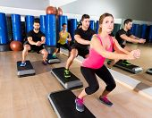 picture of step aerobics  - Cardio step dance squat people group at fitness gym training workout - JPG