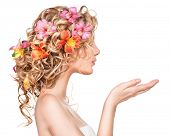 stock photo of perm  - Beauty girl with flowers hairstyle and open hands isolated on white background - JPG
