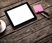 stock photo of web surfing  - Digital tablet computer with sticky note paper and cup of coffee on old wooden desk - JPG
