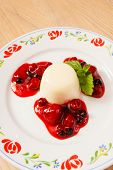 stock photo of panna  - Panna cotta with berry sauce - JPG