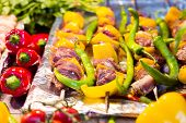 stock photo of buffet  - Beef on skewer on a display in an open buffet restaurant