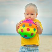 stock photo of laughable  - Baby playing with toy ball - JPG