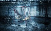 stock photo of poverty  - Old rusted playground - JPG