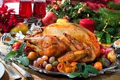 stock photo of turkey dinner  - Roasted turkey on holiday table - JPG