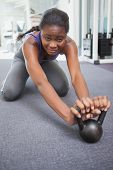 pic of kettlebell  - Fit woman working out with kettlebell at the gym - JPG