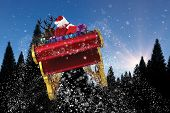 picture of santa sleigh  - Santa flying his sleigh against snow falling on fir tree forest - JPG