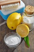 picture of baking soda  - Homemade green cleaning.Lemon and baking soda on old wooden background ** Note: Soft Focus at 100%, best at smaller sizes - JPG