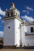image of senora  - Bell tower of the Basilica of Our Lady of Copacabana in the small tourist town of Copacabana at Lake Titicaca in Bolivia - JPG