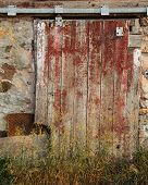 stock photo of red barn  - Textured barn door from a weathered barn - JPG