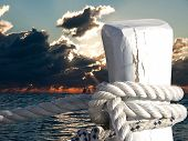foto of bollard  - bollard on sunset with the boats on a sea - JPG