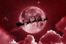 foto of stelles  - Santa flying in his sleigh against a full moon background with stars and clouds - JPG