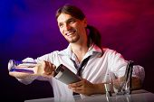 picture of bartender  - Young stylish man bartender preparing serving alcohol cocktail drink over bar counter