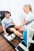 picture of physiotherapy  - Patient at the physiotherapy doing physical exercises using leg press in sport remobilization - JPG
