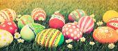 stock photo of grass  - Easter Eggs with flower on Fresh Green Grass  - JPG
