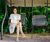 picture of swingset  - Woman sitting on the swingset - JPG