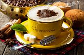 picture of sugar cube  - Hot Cappuccino in a yellow cup with sugar cubes - JPG