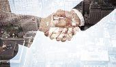 picture of handshake  - Handshake between two business people against new york - JPG