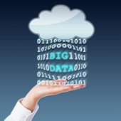 stock photo of palm  - Big data discovered in a parallel data stream flowing between an open palm and a blank cloud computing icon - JPG