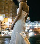 stock photo of night gown  - Beautiful bride on street in the night - JPG