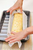 foto of torta  - hands expand Swiss roll  - JPG