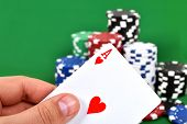 pic of poker hand  - Ace in hand and poker chips stack - JPG