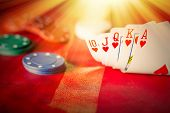 foto of poker hand  - Heavenly light illuminates a winning hand in this poker background photo - JPG