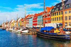 stock photo of historical ship  - Scenic summer view of Nyhavn pier with color buildings - JPG