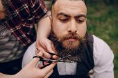 picture of shaved head  - two bearded men shave outdors shave brutall - JPG