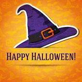 image of witch  - Happy halloween greeting card with witch hat sticker cut from the paper and placed between ribbon and background - JPG