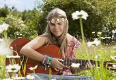pic of hippy  - Beautiful hippie girl with guitar sitting in the grass - JPG