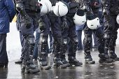 image of truncheon  - Riot Police unit waiting for orders - JPG
