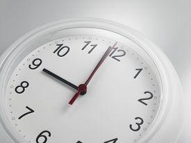 image of analog clock  - Close up of an analog clock at 9 o - JPG