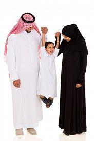 foto of muslim  - cheerful young muslim family having fun on white background - JPG