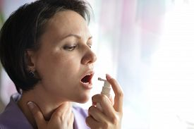stock photo of squirt  - Portrait of a sick Woman squirting throat - JPG