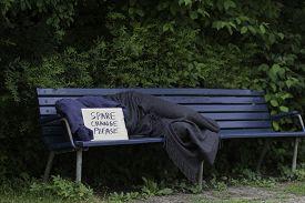 stock photo of scourge  - Homeless man sleeping on a park bench - JPG