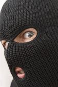 stock photo of shoplifting  - evil angry criminal wearing black military mask - JPG