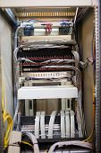 Open locker of rack mounted server in server room poster