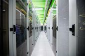 Hallway with a row of servers in server room poster