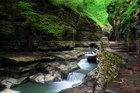 picture of landscapes beautiful  - Beautiful landscape of slow motion waterfall cascading over rocks which show various layers and effects of erosion - JPG