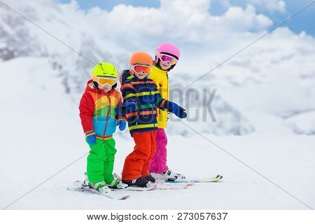 poster of Family Skiing In Mountains. Mother And Kids Ski In Swiss Alps During Winter Christmas Vacation. Acti