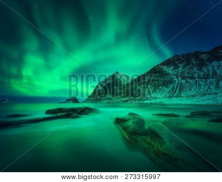 Aurora Borealis Above Snowy Mountain