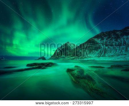 Aurora Borealis Above Snowy Mountain
