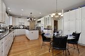 image of light fixture  - Modern kitchen with island and eating area - JPG